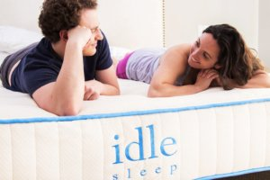 a couple on the IDLE hybrid mattress