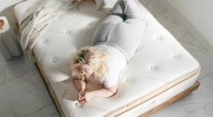 View of the Saatva HD mattress with somebody on it