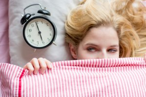 Image: woman unhappy to be waking up