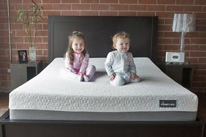 babies sitting on the mattress