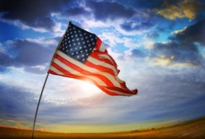 Image: American flag backlit with a mid-afternoon sun