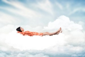 Woman asleep on a cloud