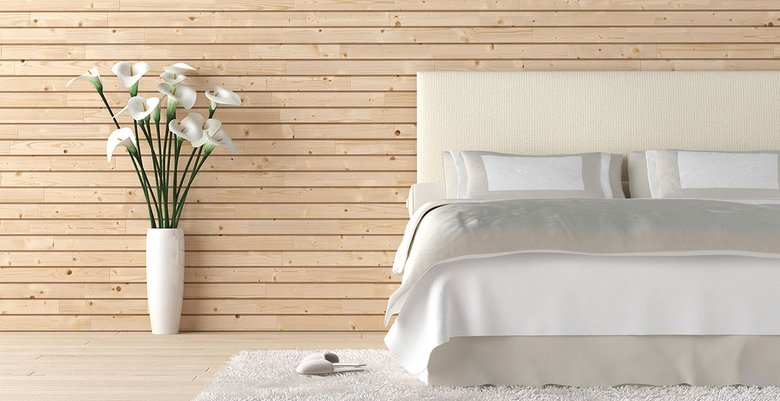 A modern bedroom with a great mattress and wonderful whiteflowers