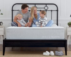 Happy family on the Boll & Branch bed