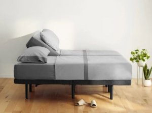 A split Casper Adjustable Bed Frame with pillows and blankets