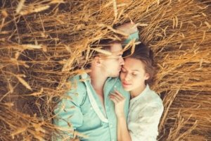 Image: young couple asleep in a field