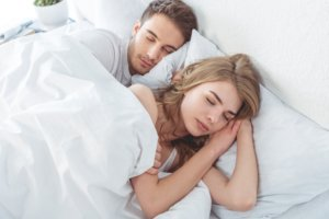 Image: couple asleep in bed