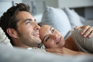 Image: couple together in bed