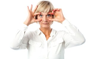 Image: middle-aged woman holding her eyes open