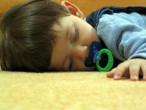 sleeping baby on the floor