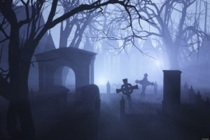 Image: spooky graveyard late at night