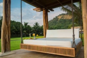 An outdoor bed, open to clean breezes.