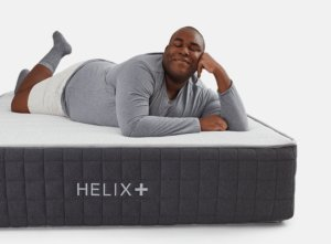 View of the Helix Plus mattress with a man on it