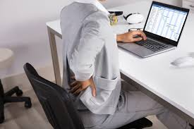 Man sitting in an uncomfortable chair