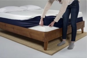 tucking in sheets on a mattress