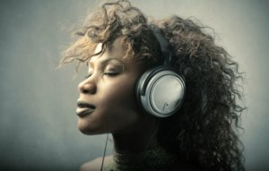 Image: woman in headphones listens to music