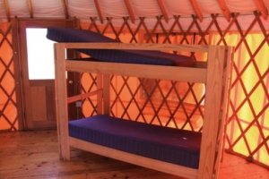 bunk bed with lifted mattress on top
