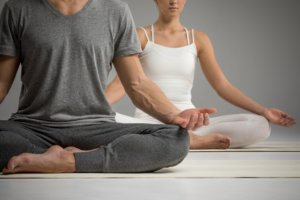 Image: couple meditating in lotus position