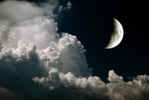 Image: crescent moon on a cloudy night