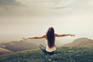 girl sits with her arms outstretched