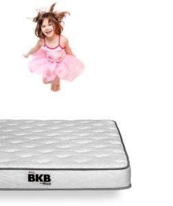 A girl jumping on a Nest Bedding BKB