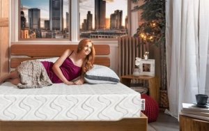 The Nest Bedding Love and Sleep Mattress with a women lying down on top of it