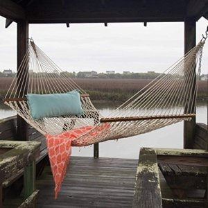 Image: a pawleys island hammock strung out on a dock