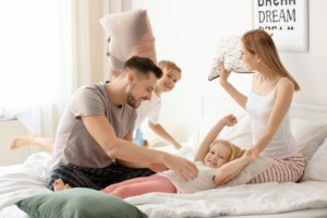 Image: happy family in a pillow fight