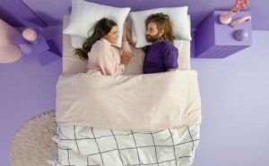 view of the Purple Hybrid mattress with people on it
