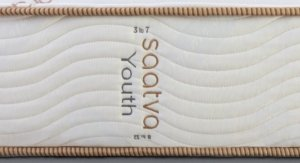 View of the saatva youth mattress with the printed logo