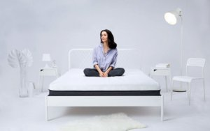 Girl sitting on the SleepCo bed