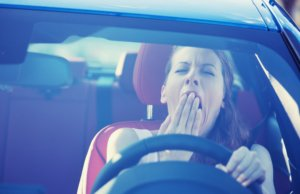 Image: woman yawns while driving