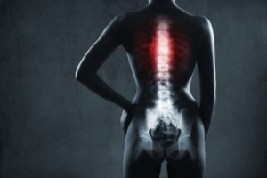 Image: silhouette with glowing x-ray of spine