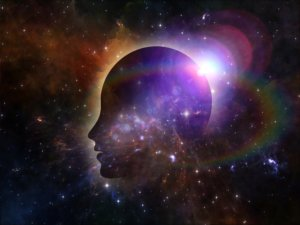 Image: psychedelic representation of the mind as a profile against a cosmic backdrop