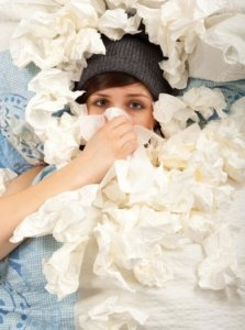 Image: woman buried in used tissues