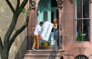 The Tuft & Needle Hybrid Mattress being delivered to a customer's door