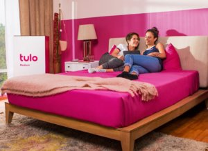 Two girls smiling on a Tulo Liv mattress