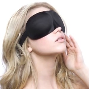 Image: woman wearing unimi sleep mask