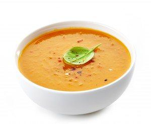 Bowl of squash soup on a white background