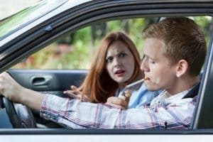 Woman mad at man for smoking cigarette in car