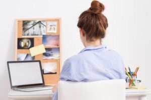 Young woman working in creative desktop