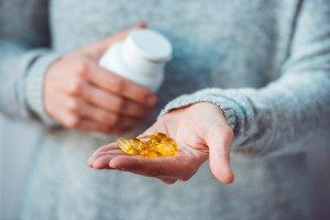 Pills in hands. Medicine and health care concept