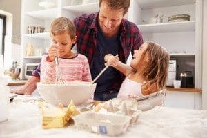 Father baking with children. Having fun