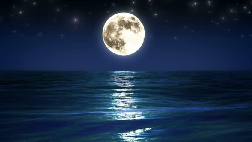 Glowing Full Moon Over Ocean