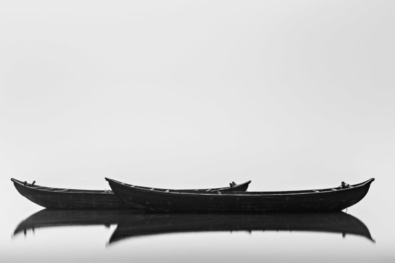 Black Boats – Classic Minimalistic Black and White Long Exposure Photograph in Limited Edition Pigment Prints (Canvas/Matte Paper)