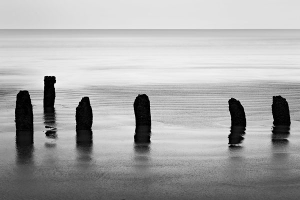 Broken Fences - Minimalistic Black and White Photograph of Shankarpur Sea Beach in Limited Edition Prints on Canvas Matte Paper by Minhajul Haque
