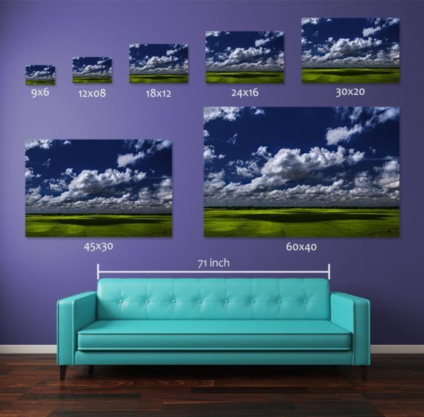 Comparing different print sizes of the photograph Shades of Clouds. The wall art prints are displayed above a standard 71-inch long couch. Smaller size 12x08-inch and 18x12-inch pigment prints are available for sale in open edition where the medium and large size prints i.e., 30x20-inch, 45x30-inch, and 60x40-inch pigment prints are available in numbered limited editions as described in the table below.