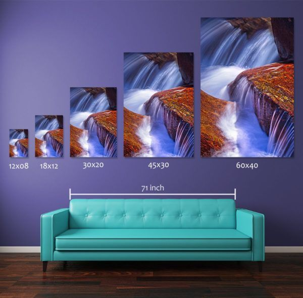 Comparing different print sizes of the photograph Shiny Red Rock. The wall art prints are displayed above a standard 71-inch long couch. Smaller size 12x08-inch and 18x12-inch pigment prints are available for sale in open edition where the medium and large size prints i.e., 30x20-inch, 45x30-inch, and 60x40-inch pigment prints are available in numbered limited editions as described in the table below.
