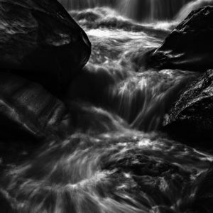 Running Stream - Black and White Photograph of Waterfall in Limited Edition Pigment Prints on Canvas and Matte Paper by Minhajul Haque