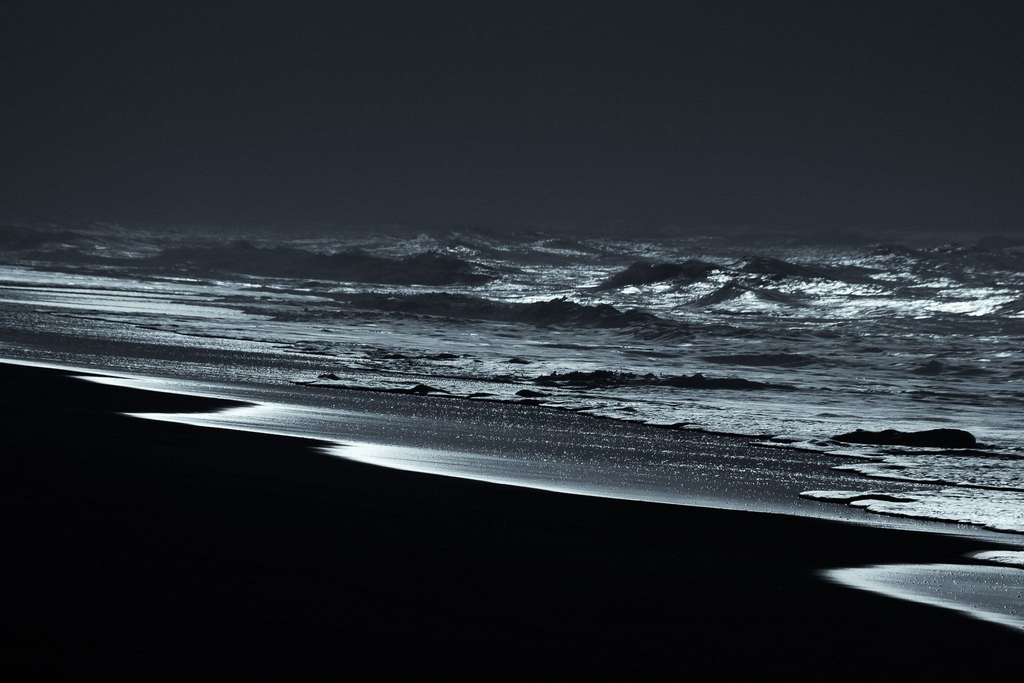Silvery Sea Shore - Black and White Photograph of Sea Beach in Limited Edition Pigment Prints on Canvas and Matte Paper by Minhajul Haque